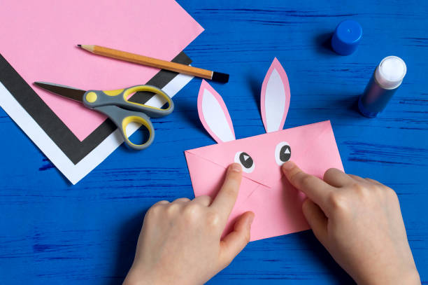 How to make envelope in form of bunny for Easter greetings. Step 9 stock photo