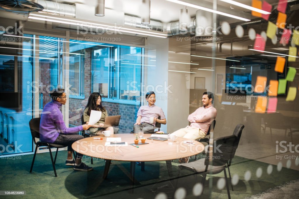 Start-up businesses are developed in coworking spaces in London,...