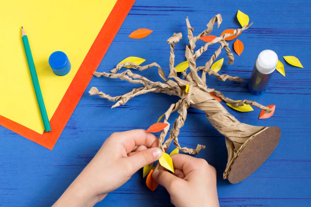 How to make together with child autumn tree. Step 9 stock photo