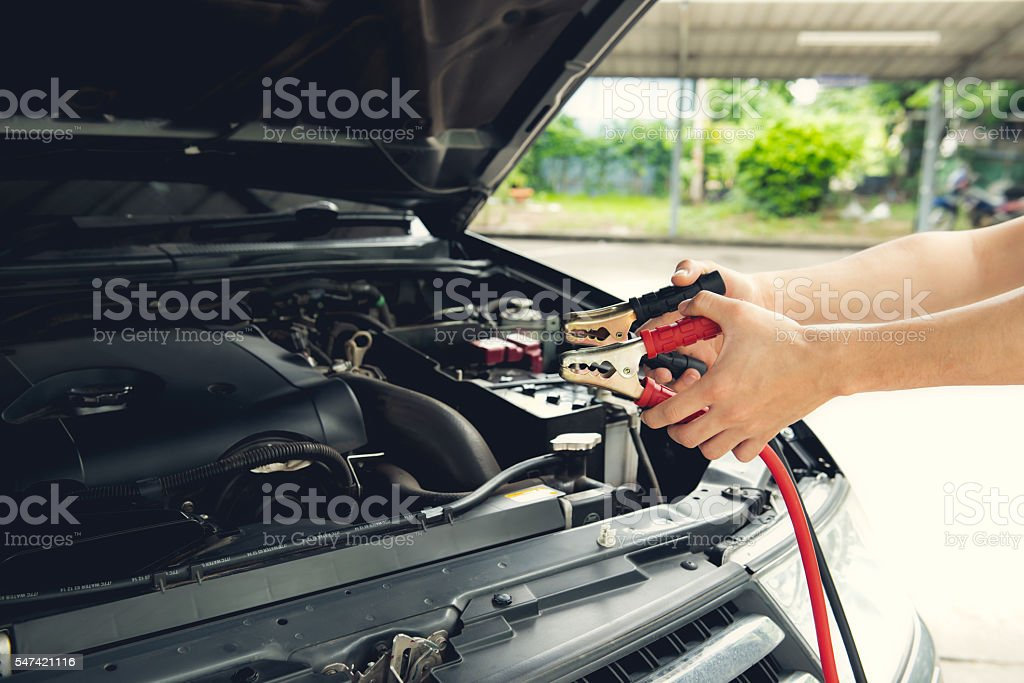 How to uses battery jumper cables stock photo