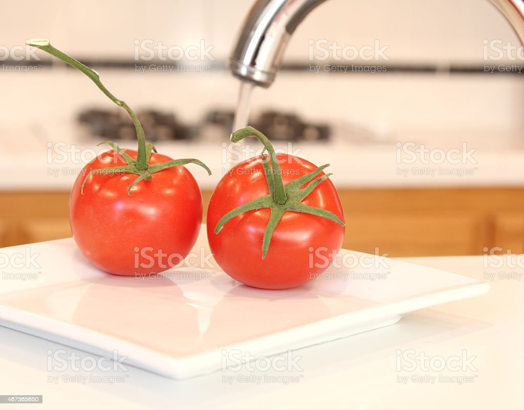 How well do I need to wash my vegetables? stock photo