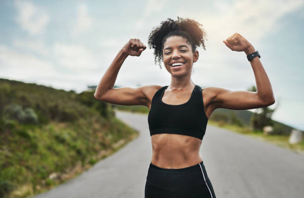 How you like me now? Cropped portrait of an attractive young sportswoman flexing her biceps outside bicep stock pictures, royalty-free photos & images