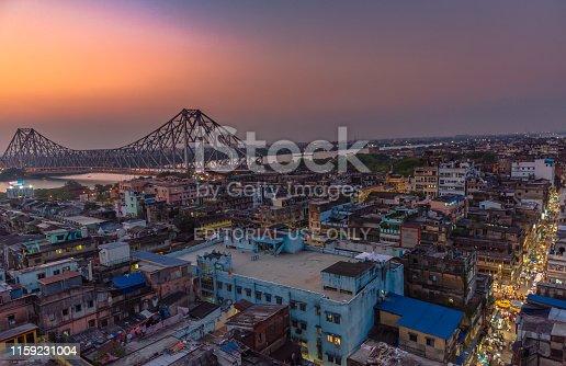 Kolkata, West Bengal, India. April 25,2019. Aerial View of Famous Howrah bridge/ Rabindra Setu along with Burrabazar/ Barabazar area.