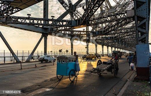 Kolkata, West Bengal/ India - August 11,2019. Howrah Bridge with Yellow Taxi.