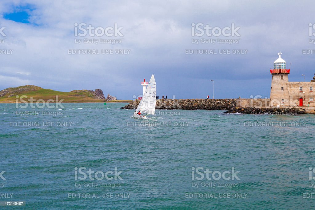 Howth Lighthouse and Sail Boat, Ireland stock photo