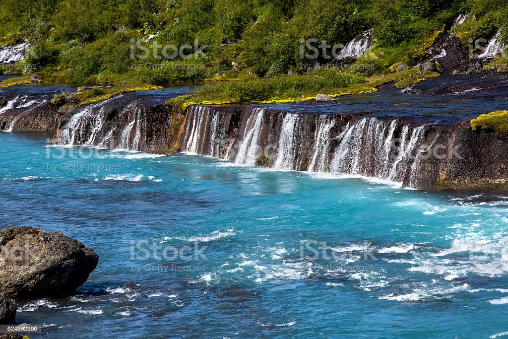 Hraunfossar series of waterfalls formed by rivulets streaming ov stock photo