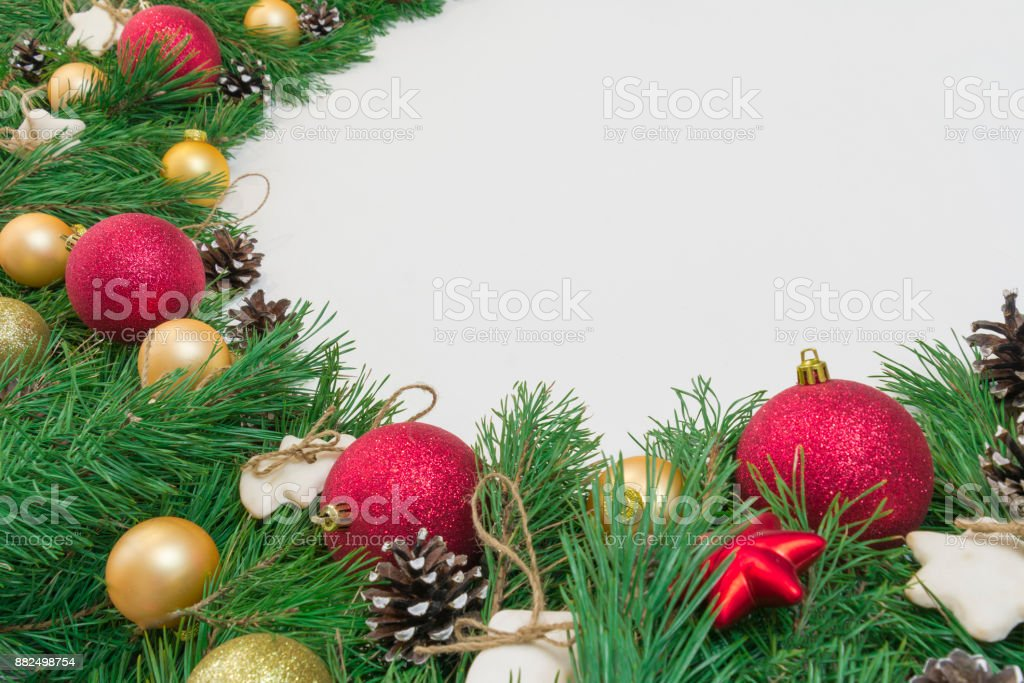 hristmas garland, frame with green natural pine branches with cones on white wooden background stock photo