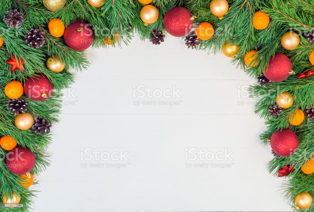 hristmas garland with green natural pine branches with cones on white wooden background stock photo