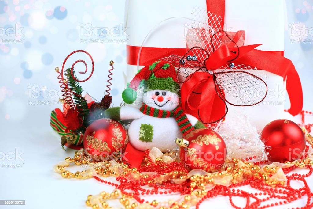 hristmas gift and snowman on a festive background stock photo