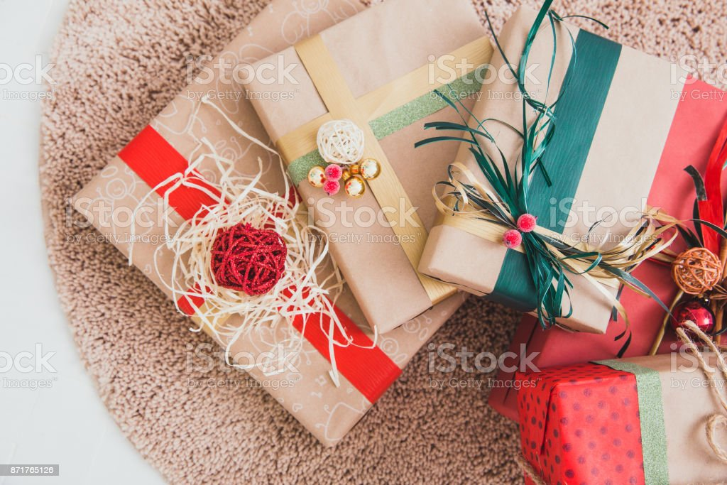 hristmas gifts on a brown carpet stock photo