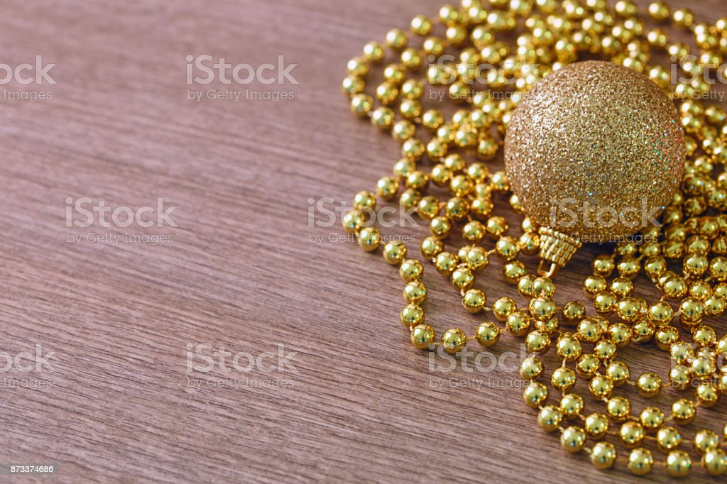 hristmas golden decoration over wood stock photo