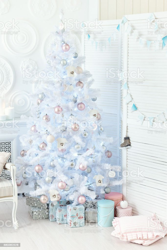 Ð¡hristmas tree with colorful balls and gift boxes over white wall. stock photo