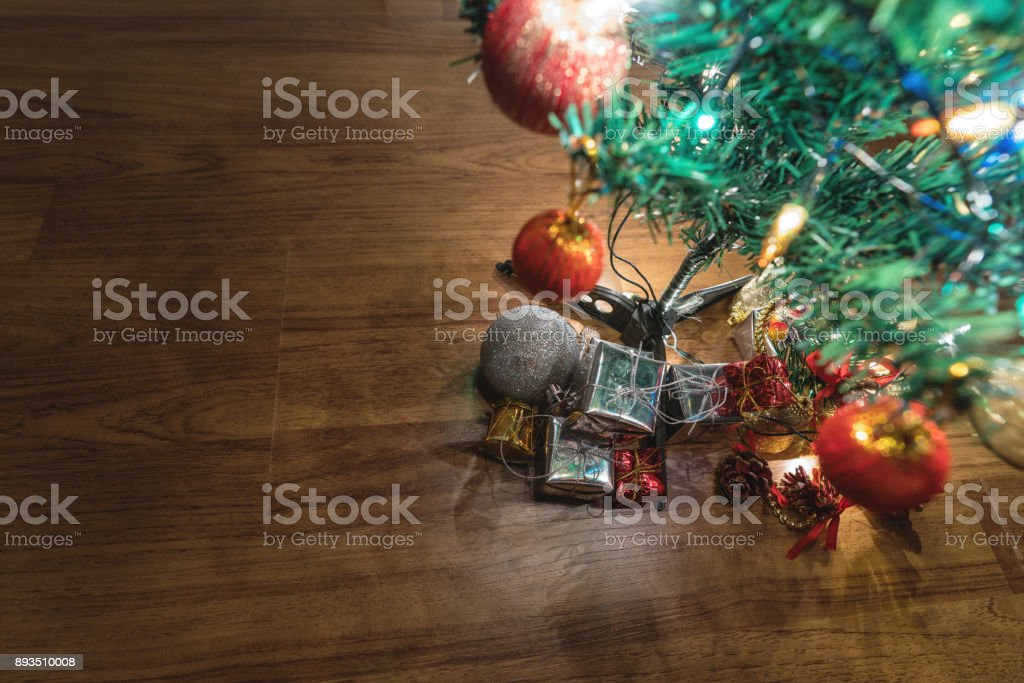 hristmas trees with gift boxes and decorations on wooden floor stock photo