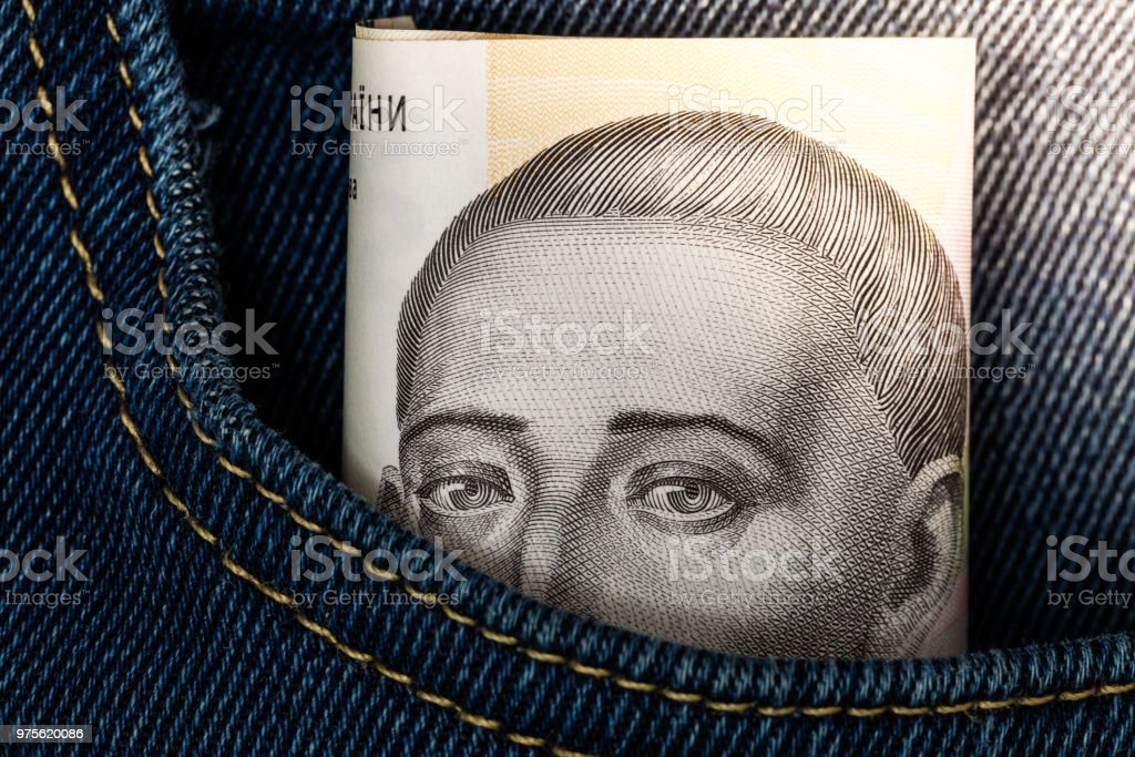 500 hryvnya banknote in jeans pocket stock photo