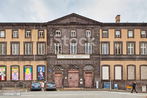 Clermont-Ferrand, France - December 11 2019: The Hôtel-Dieu is the site of an old hospital dating back to the 18th century, located in the southern part of the historic center of the city.