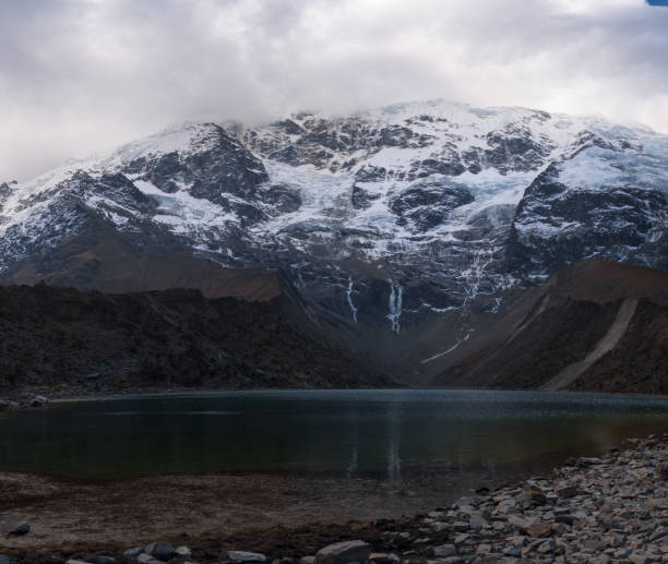 Huamantay Lake with snowcapped Huamantay Mountain in the background stock photo