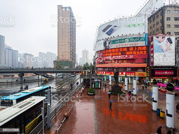 Changsha, China - November 9, 2012: View of the buildings and the people along Huang Xing road in Changsha, China on a rainy afternoon.