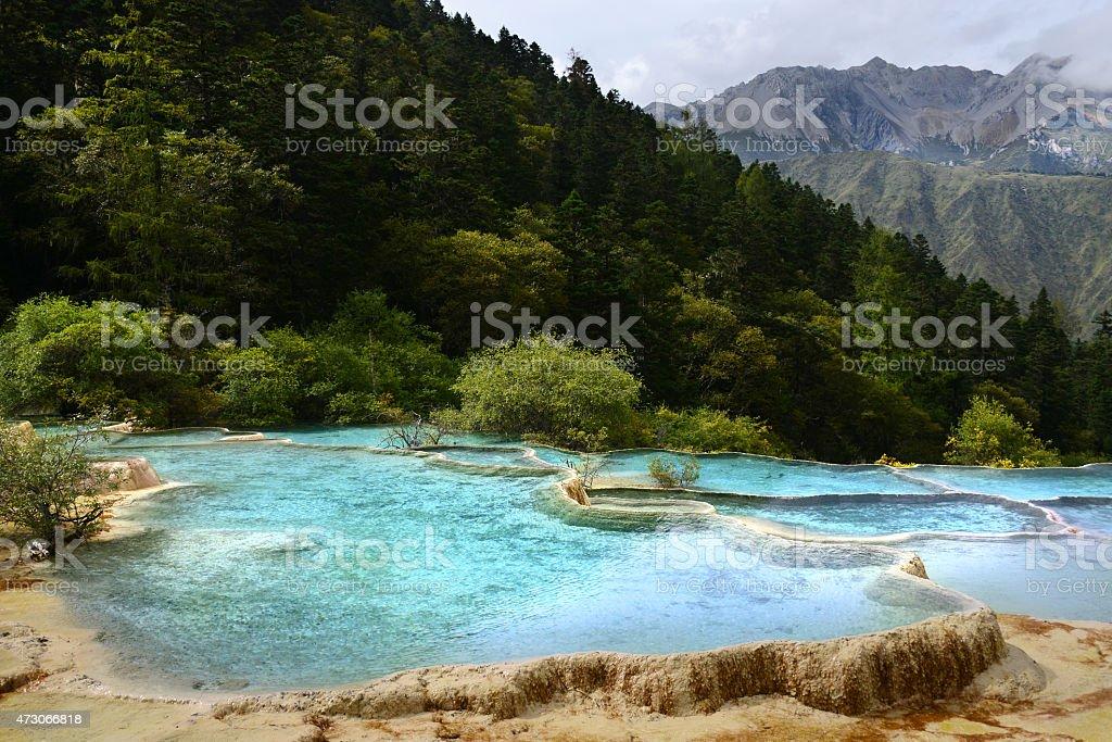 Huanglong National Park blue pond near Jiuzhaijou Sichuan, China stock photo