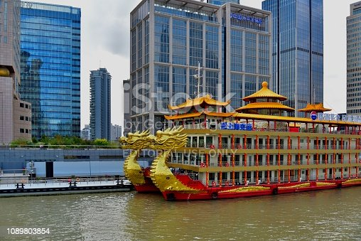 The Huangpu Jiang You Lan river cruise and dinner boat dock on the Bund in Shanghai waiting for nightfall when it will take tourist for a tour on the Huangpu river.