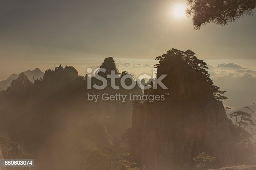 One of the Huangshan peaks during a foggy sunrise