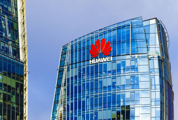 Huawei head quarter modern building with red logo Vilnius, Lithuania - November 21, 2017: Huawei headquarter office building in Vilnius huawei stock pictures, royalty-free photos & images