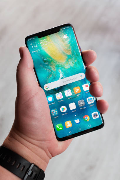 Huawei Mate 20 Pro smartphone homescreen BUDAPEST, OCTOBER 2018 - Recently launched Huawei Mate 20 Pro smartphone is displayed for editorial purposes. Shallow focus effect. huawei stock pictures, royalty-free photos & images