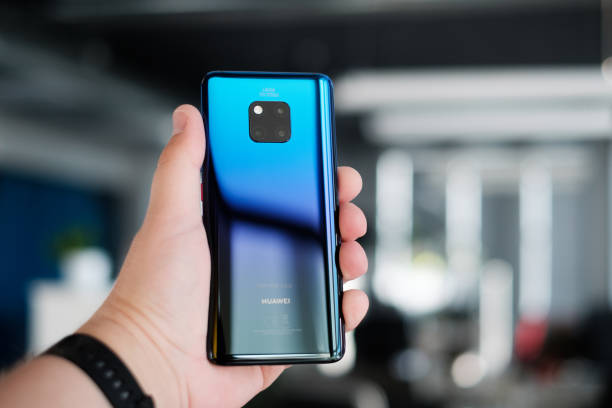 Huawei Mate 20 Pro smartphone cameras RIGA, OCTOBER 2018 - Recently launched Huawei Mate 20 Pro smartphone is displayed for editorial purposes. Shallow focus effect. huawei stock pictures, royalty-free photos & images