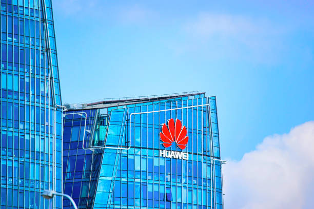 Huawei Technologies company headquarter at skyscraper in Vilnius Vilnius, Lithuania - August 8, 2017: Huawei Technologies company headquarter at the modern office building skyscraper in the business district of Vilnius, Lithuania. huawei stock pictures, royalty-free photos & images
