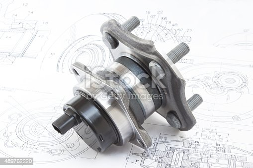 istock hub with bearing. on the background of drawings and plans 489762220