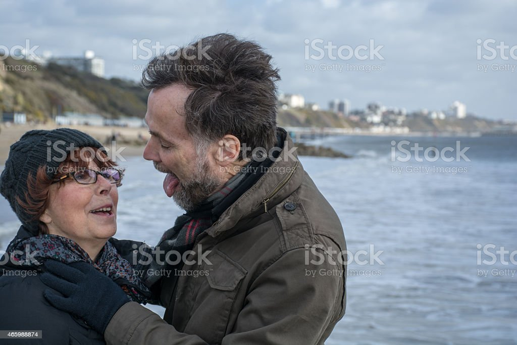 Huband about to lick his wife stock photo