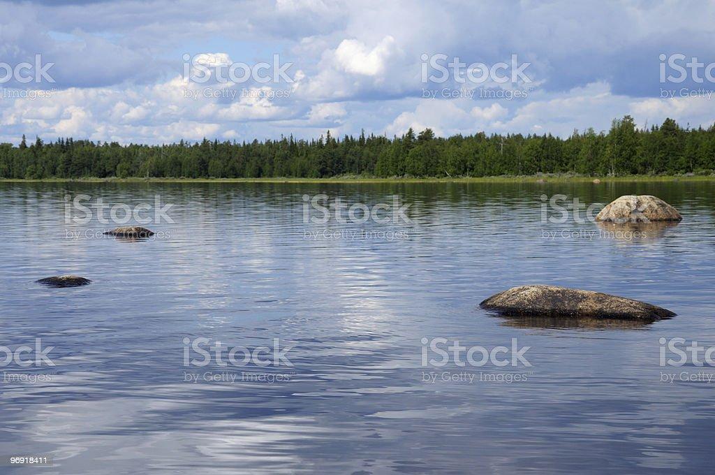 Hude boulders in nothern Karelian lake royalty-free stock photo
