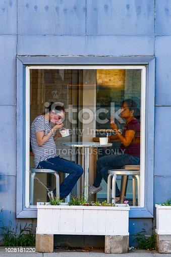 Hudson, New York, August 27, 2018 USA A couple eating ice cream in an ice cream shop window on Warren Street.