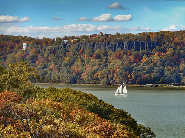 Hudson River Palisades and Sailboat in Autumn 2 Hudson River Palisades and Sailboat in Autumn hudson river stock pictures, royalty-free photos & images
