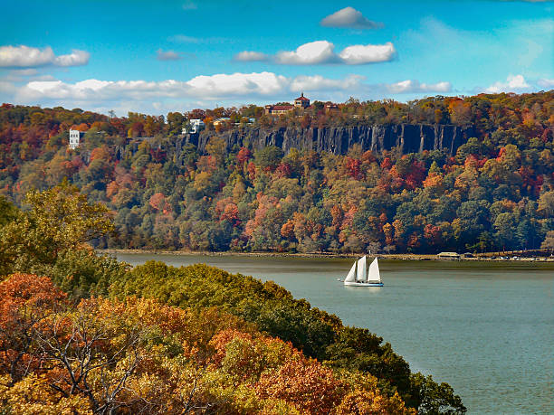 Hudson River Palisades and Sailboat in Autumn Hudson River Palisades and Sailboat in Autumn hudson river stock pictures, royalty-free photos & images