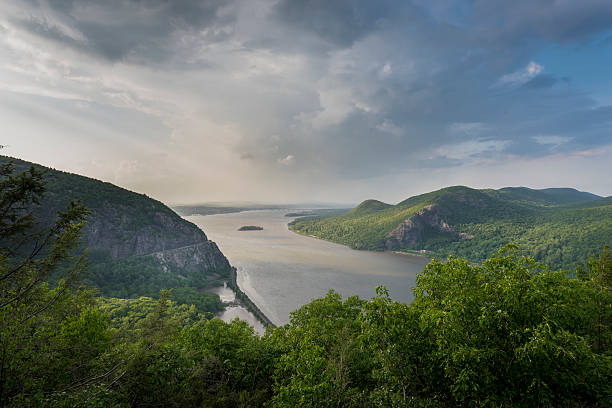 Hudson River with Storm King and Breakneck Ridge Mountains North View through the Hudson Highlands up the Hudson River with Newburgh Bay in the Distance, and Storm King Mountain on the left, and Breakneck Ridge on the right hudson river stock pictures, royalty-free photos & images