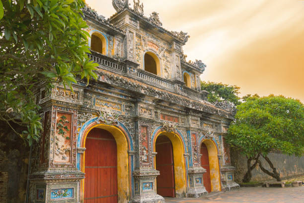 Hue citadel entrance sunset Hue citadel entrance sunset in Vietnam huế stock pictures, royalty-free photos & images