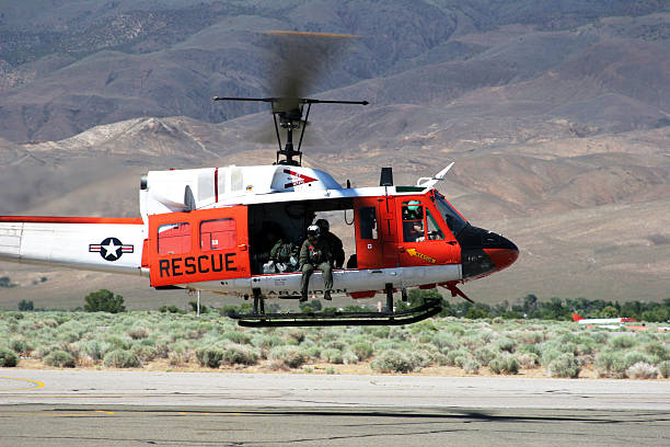 Huey Helicopter 01 Bell twin turbine helicopter.  Click on an image to go to my Fire Fighters and Paramedics Lightbox. smoke jumper stock pictures, royalty-free photos & images