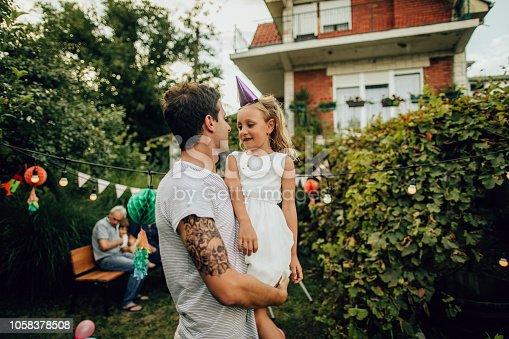 Father holding his big birthday girl
