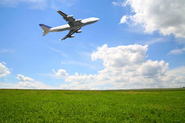 Huge airliner taking off in summer nature scene stock photo