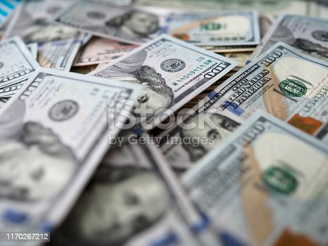 istock Huge amount of US bucks lying down at table 1170267212