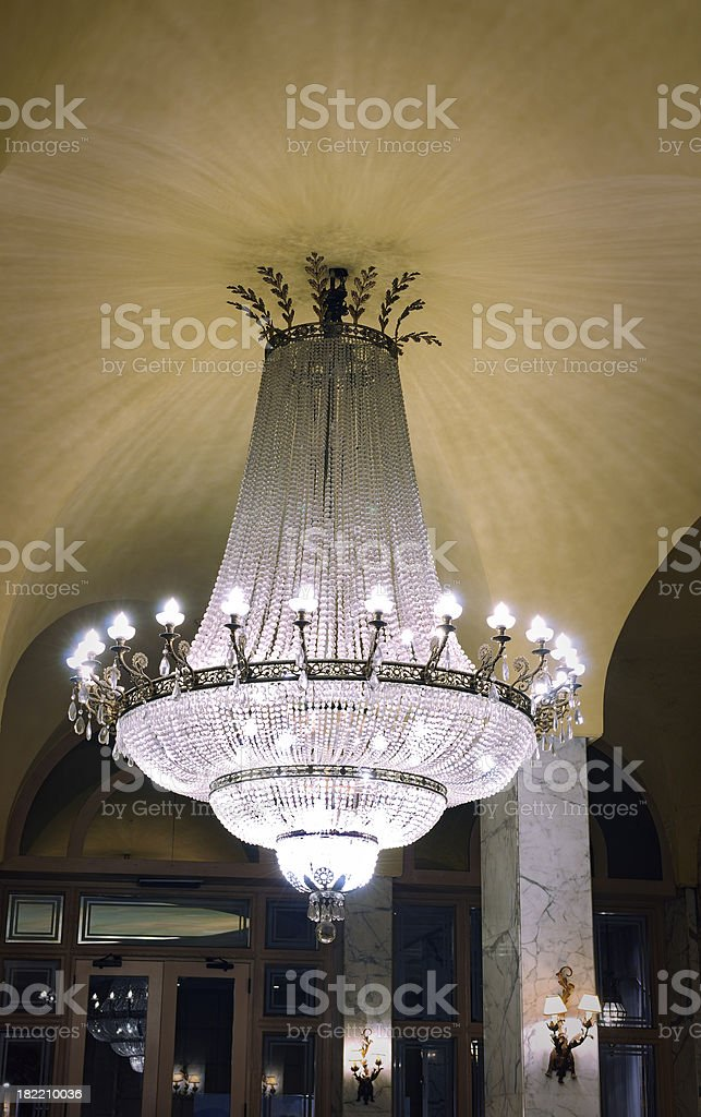huge antique crystal chandelier lamp in the lobby royalty-free stock photo