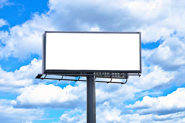 Huge blank billboard against bright blue sky Huge blank billboard against bright blue sky electronic billboard stock pictures, royalty-free photos & images