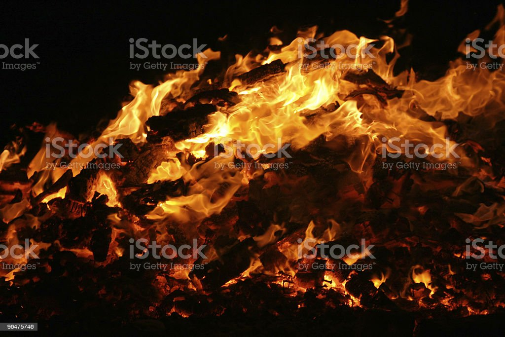 Huge bonfire burning isolated on black royalty-free stock photo