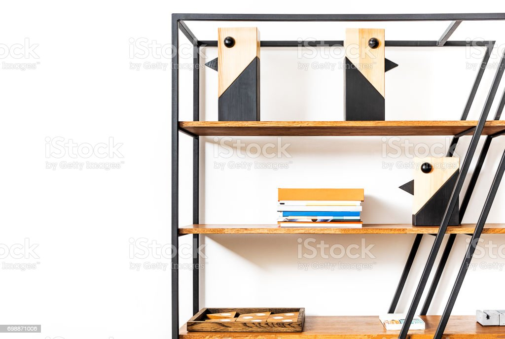 Huge bookstand with domestic whatnot on it stock photo