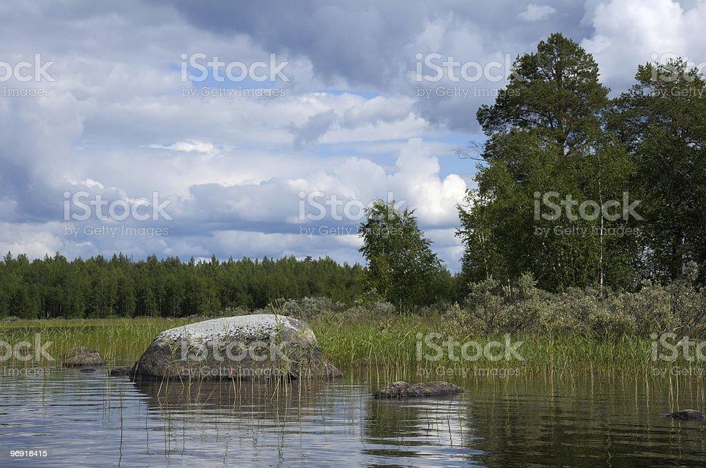 Huge boulders in northern Karelian lake royalty-free stock photo