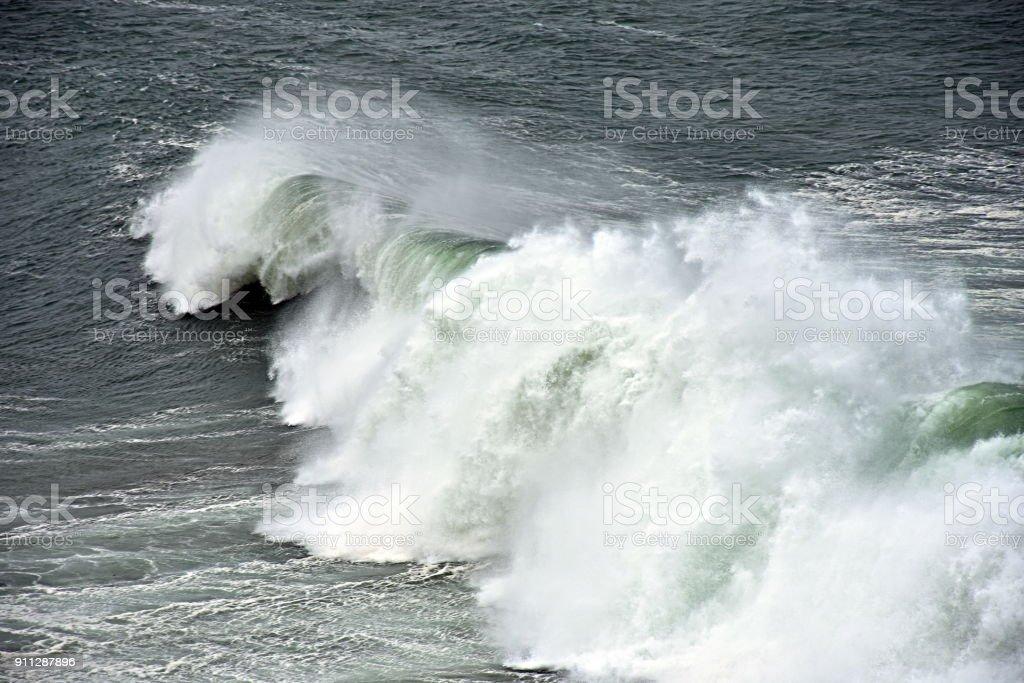 Huge breaking wave stock photo