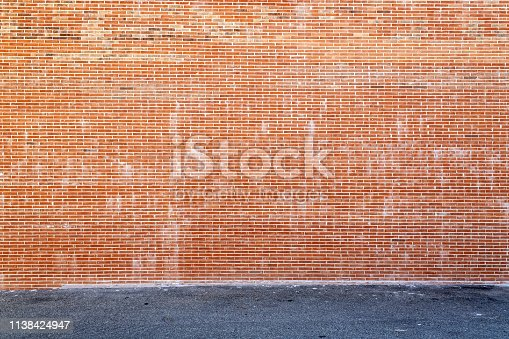 Huge brick wall and asphalt