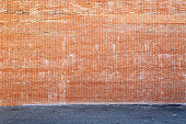 Huge brick wall and asphalt