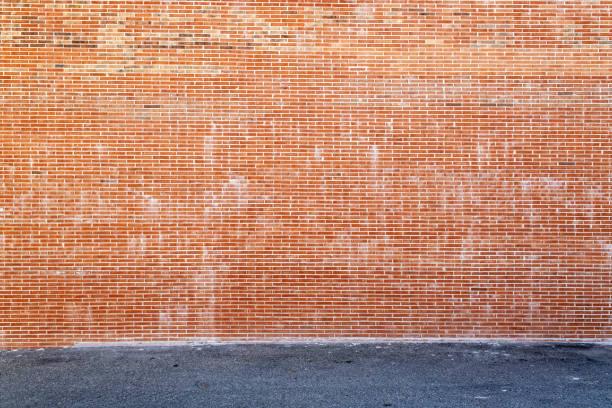 Huge brick wall and asphalt stock photo