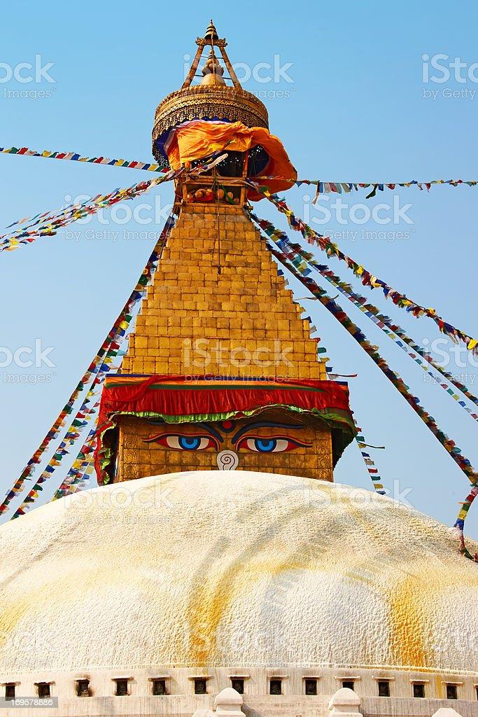 A huge buddhist stupa with colorful prayer flags in Kathmandu (Nepal) royalty-free stock photo
